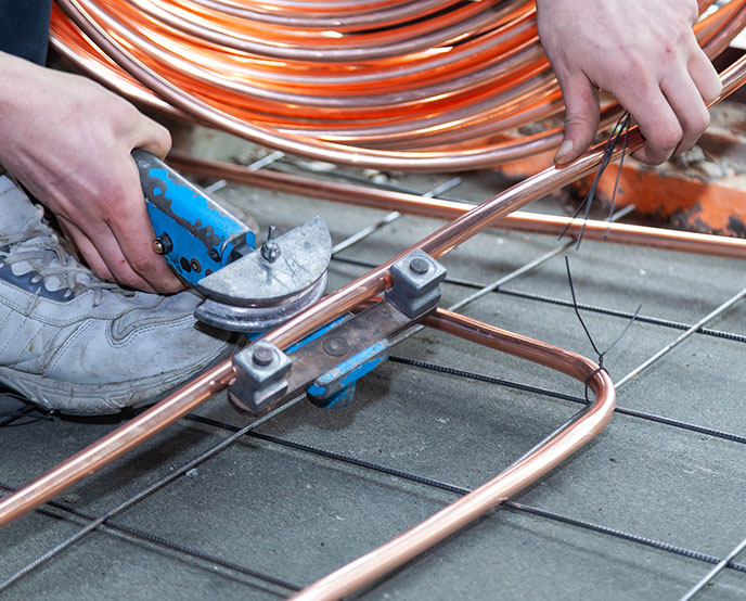 person working iwth copper